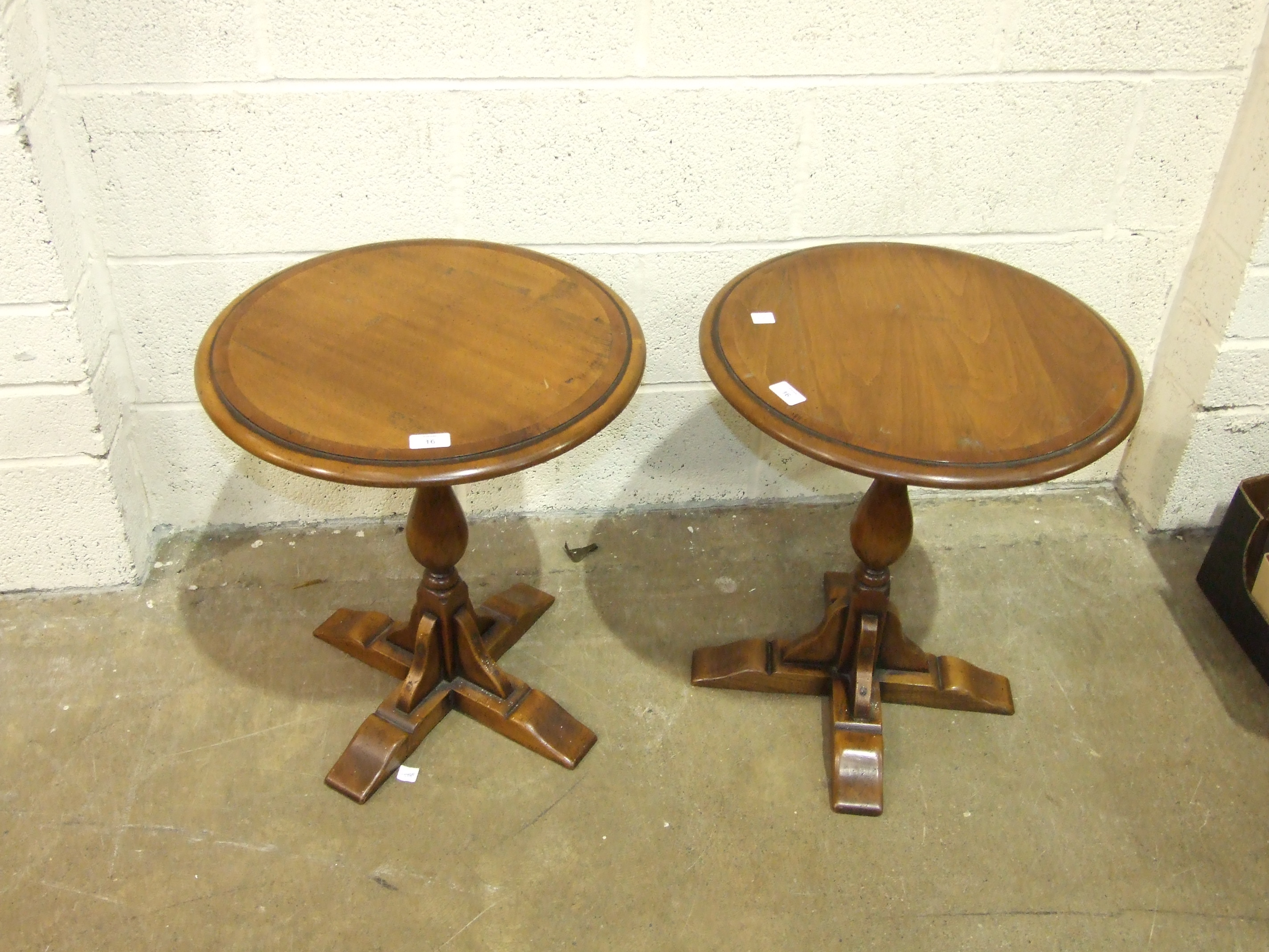 Lot 16 - Simpsons of Norfolk, a pair of hardwood circular occasional tables with yew inlay on turned