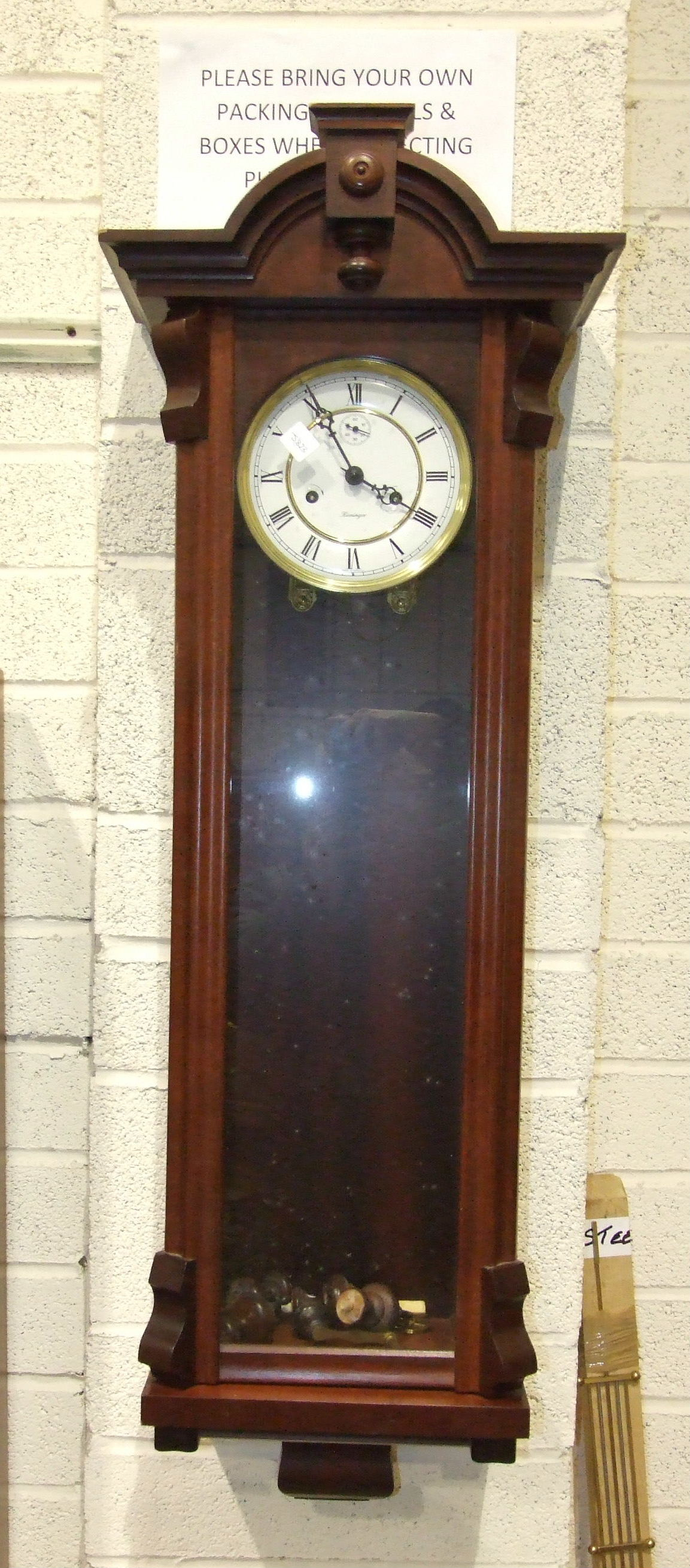 Lot 40 - A modern mahogany finish Vienna-type wall clock with gong-striking movement, enamel dial with