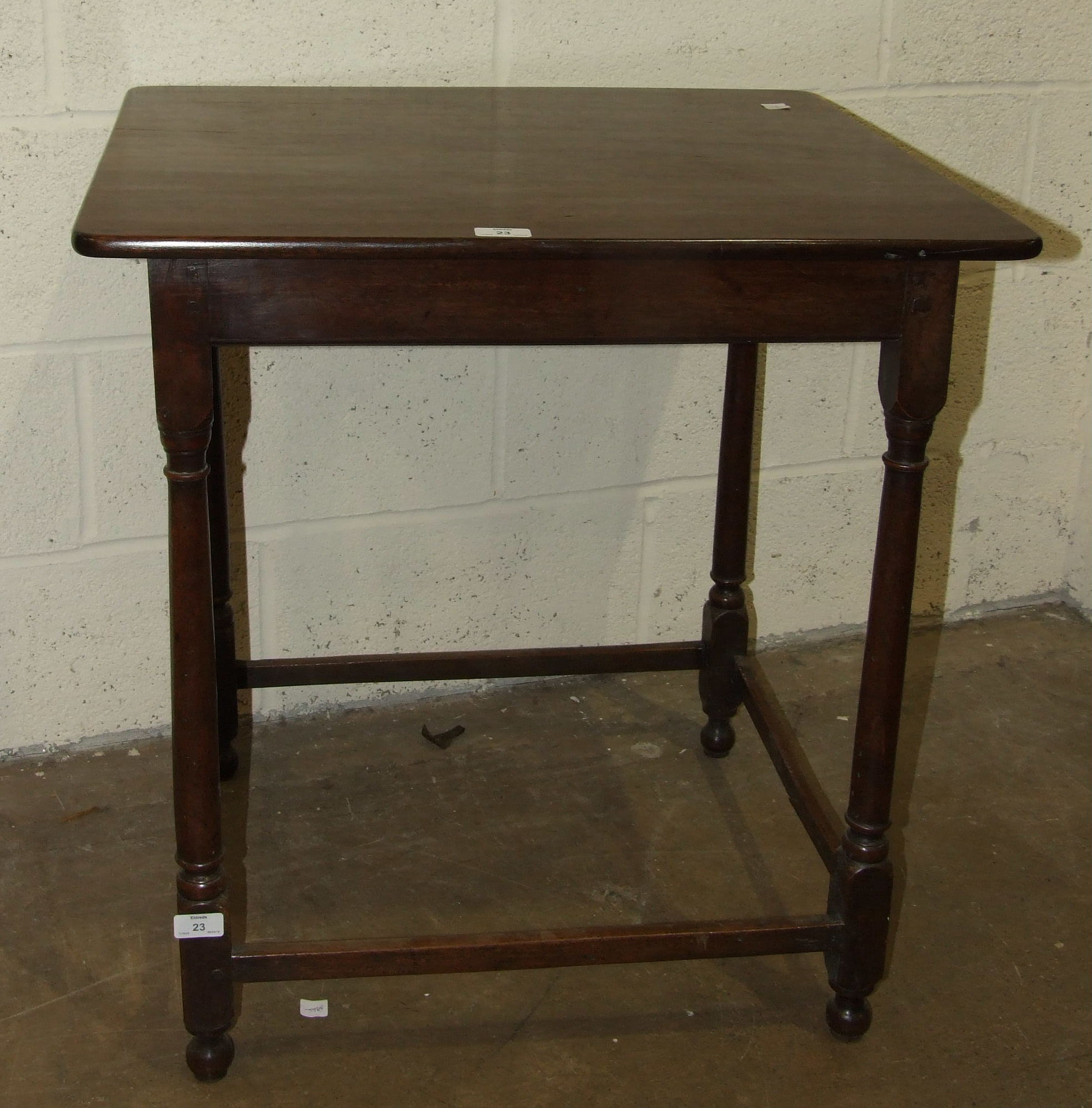 Lot 23 - A mahogany occasional table on turned legs united by stretchers, 67 x 59cm, 72cm high.