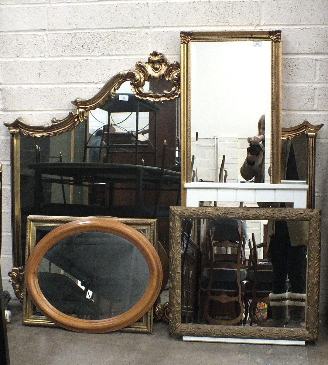 Lot 33 - A modern gilt frame over mantel mirror of shaped outline, 135cm wide, 116cm high and five other
