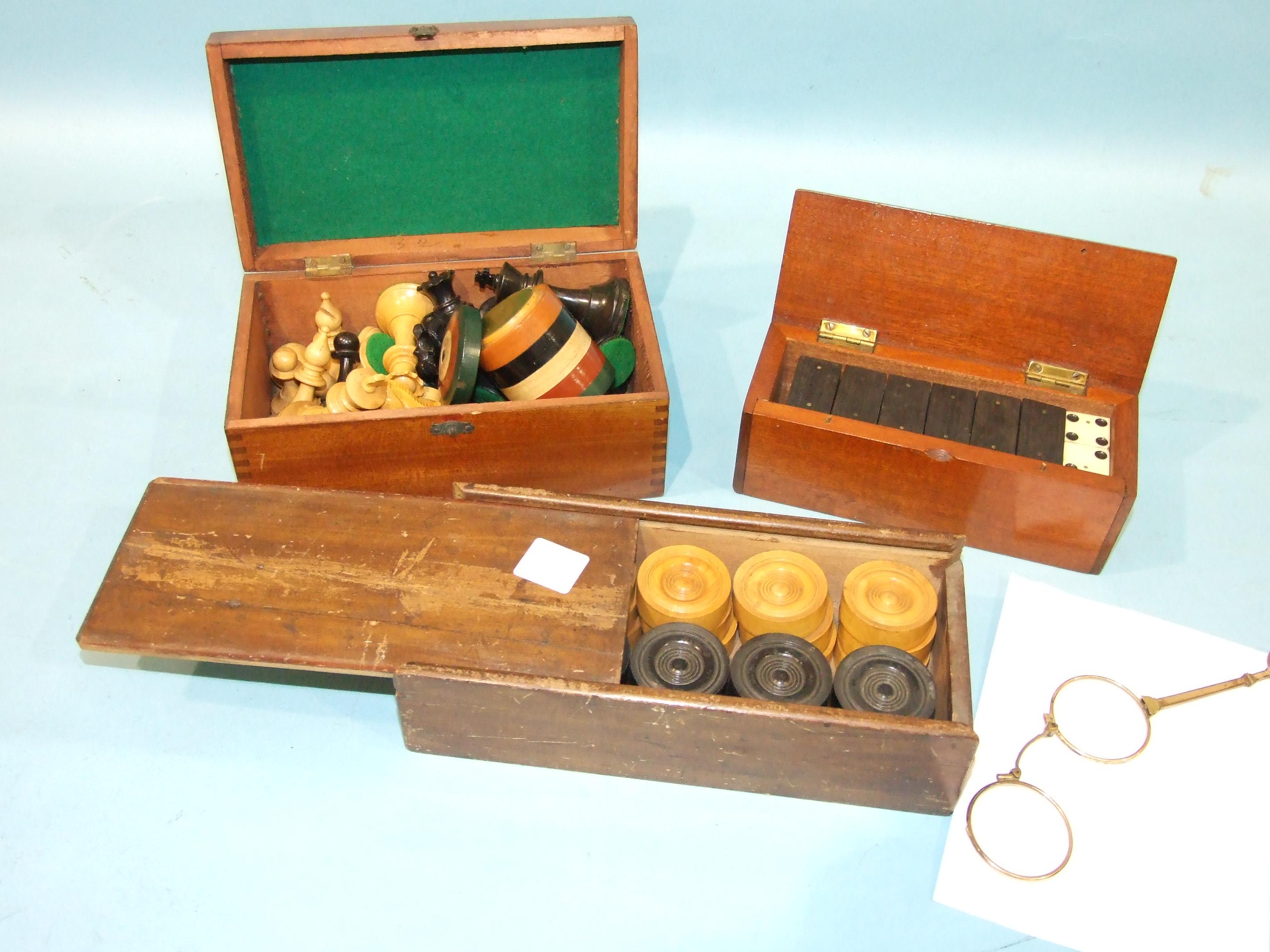Lot 113 - A set of boxwood and ebony draughts, a Staunton style chess set, a set of bone and ebony dominoes
