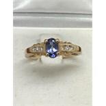TANZANITE & DIAMOND RING SET IN 14k GOLD