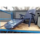 Blue plastic reclining chair
