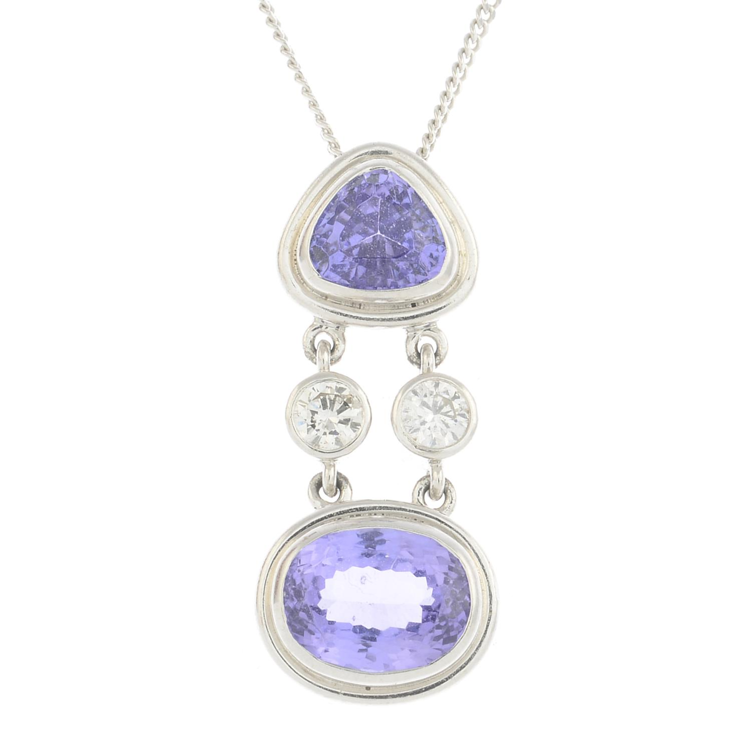 Lot 16 - A tanzanite and diamond pendant,