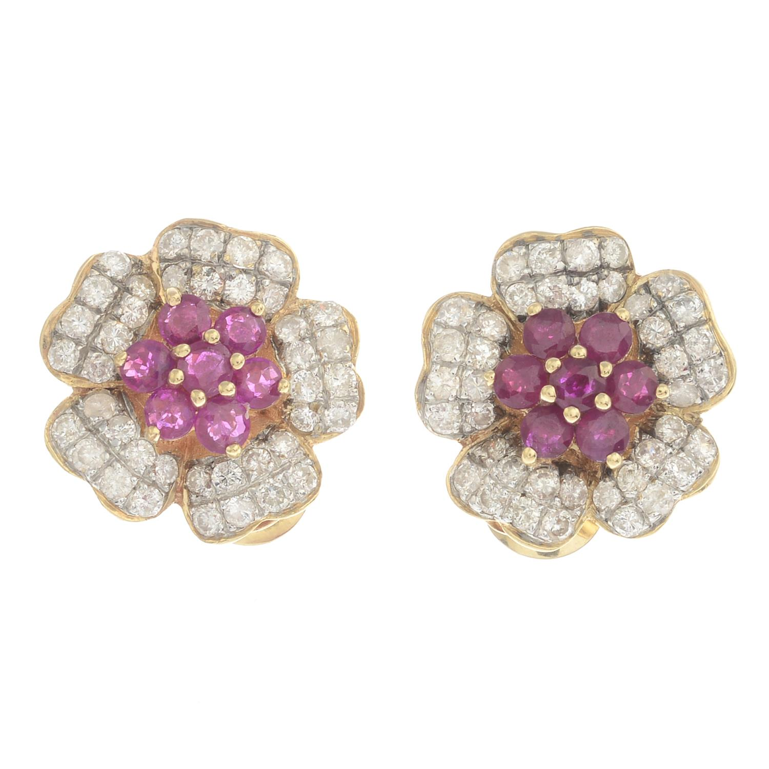 Lot 21 - A pair of ruby and diamond floral cluster earrings.Estimated total diamond weight 1.60cts.