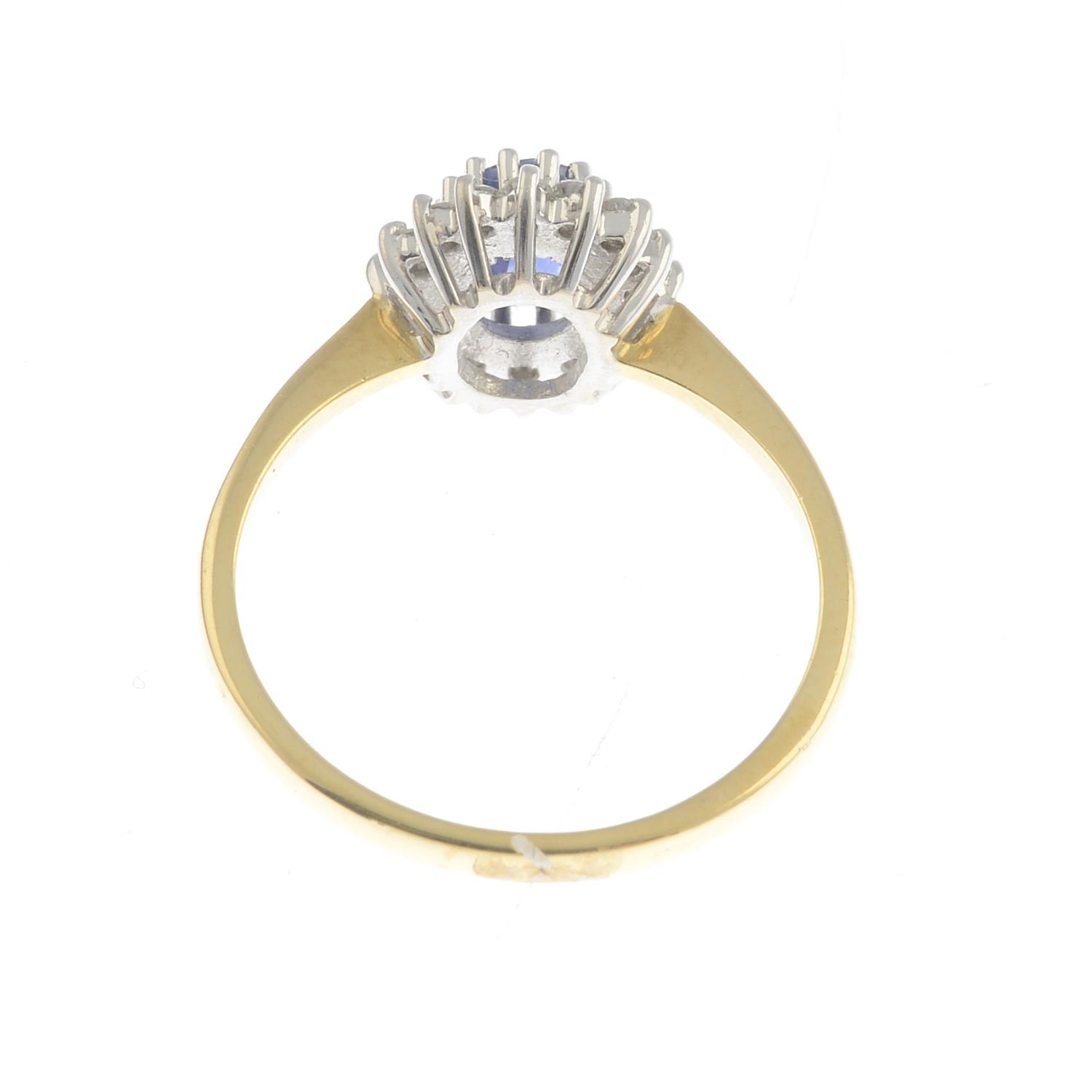 An 18ct gold sapphire and diamond cluster ring.Calculated sapphire weight 0.80ct, - Image 2 of 3