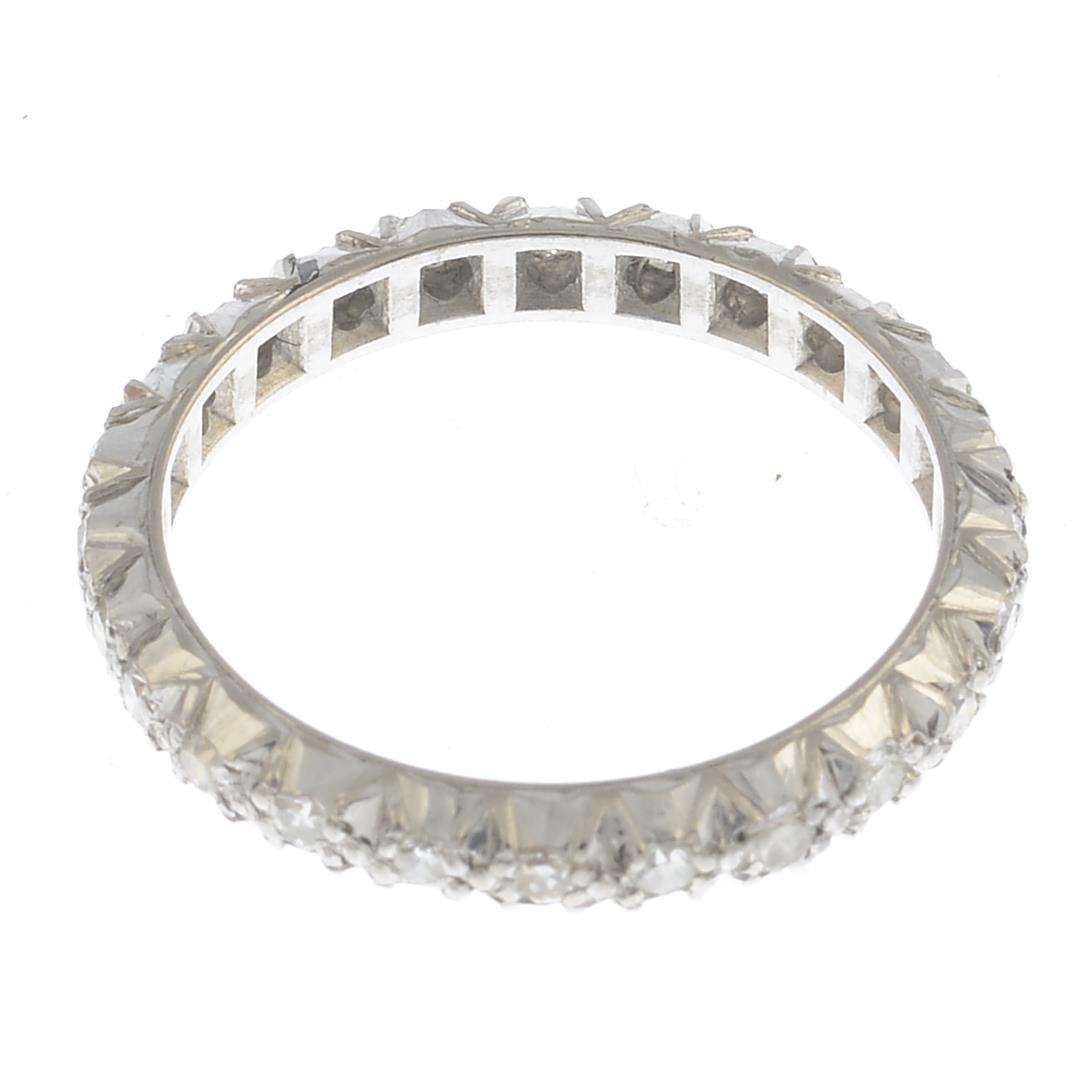 Lot 45 - A diamond full eternity ring.Estimated total diamond weight 1ct.Ring size O.