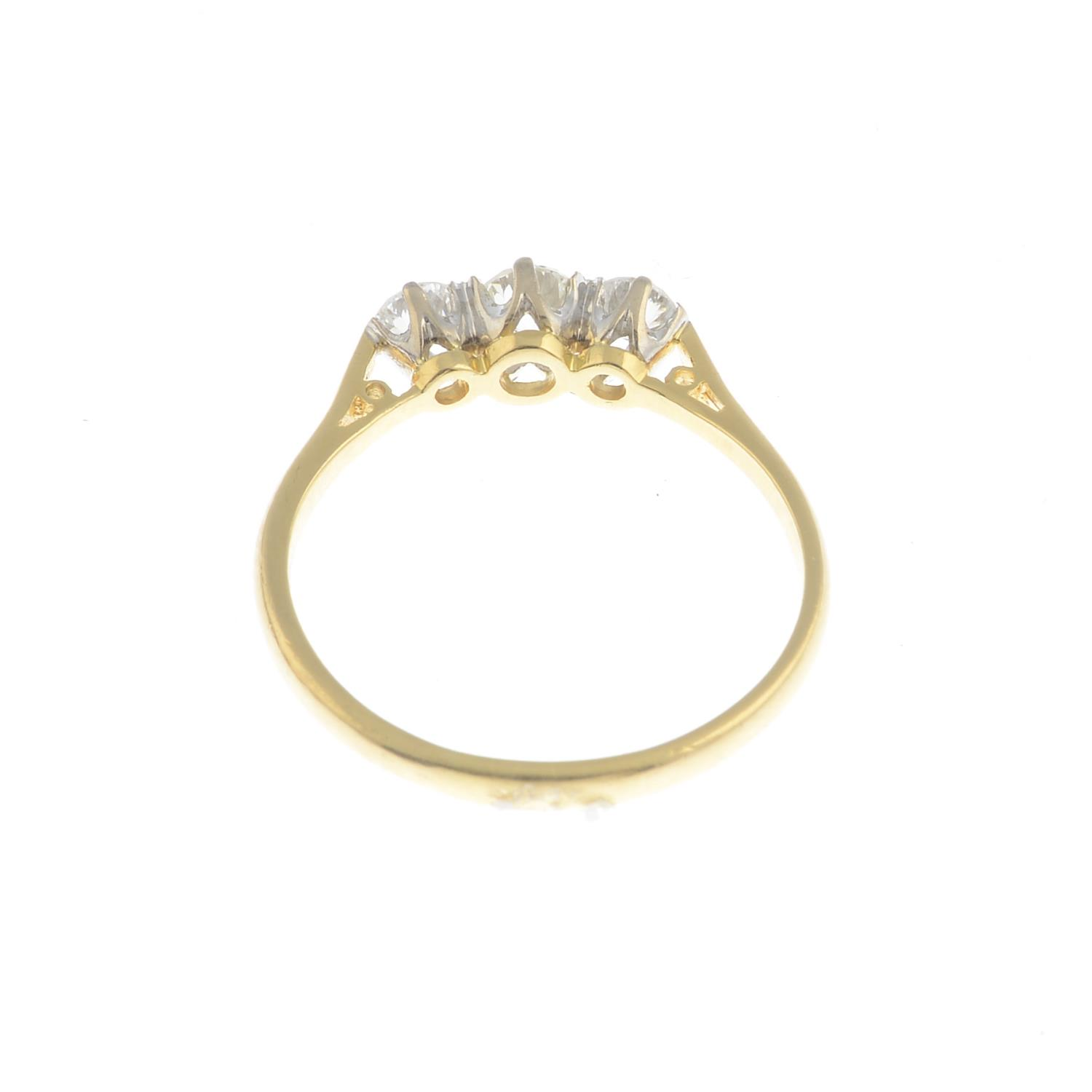 An 18ct gold diamond three-stone ring.Estimated total diamond weight 0.50ct, - Image 2 of 3