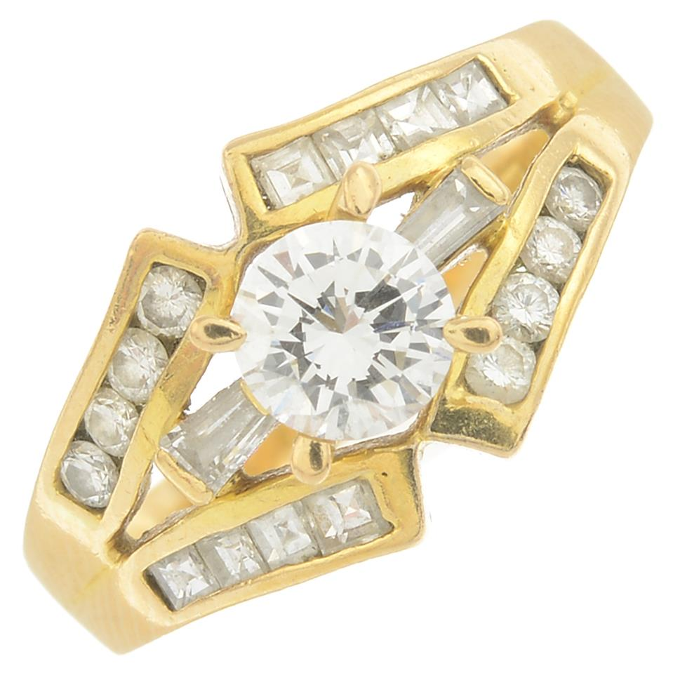Lot 1 - A diamond dress ring.Principal diamond estimated weight 0.50ct,