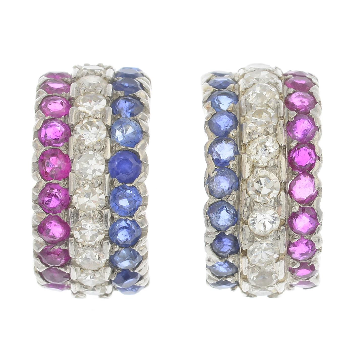 Lot 41 - A pair of sapphire, ruby and diamond half-hoop earrings.