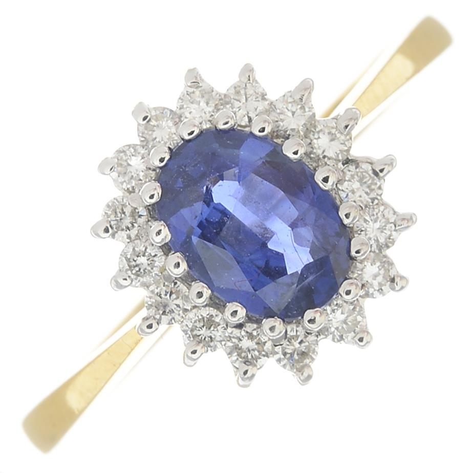 An 18ct gold sapphire and diamond cluster ring.Calculated sapphire weight 0.80ct,