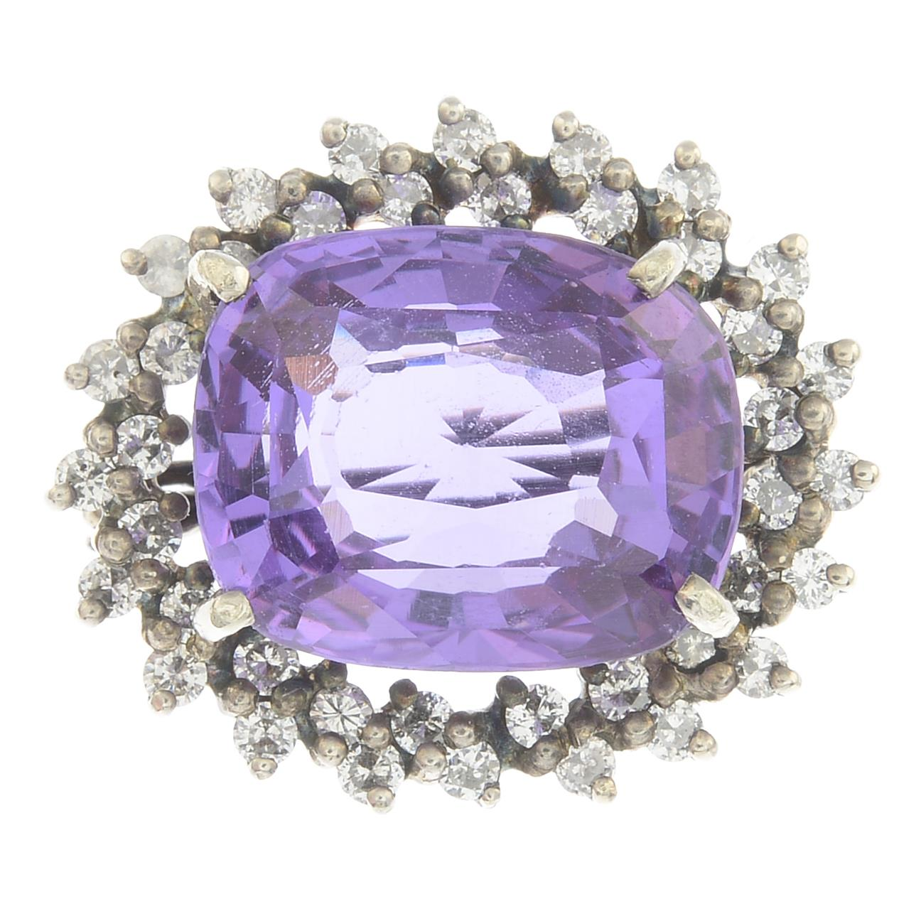 Lot 47 - A synthetic colour-change sapphire and diamond brooch.
