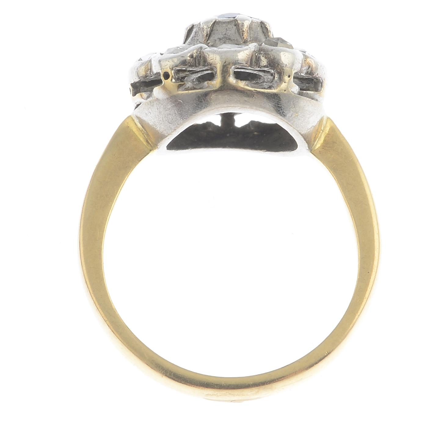 Lot 31 - A sapphire and diamond cluster ring.Sapphire calculated weight 0.60ct,