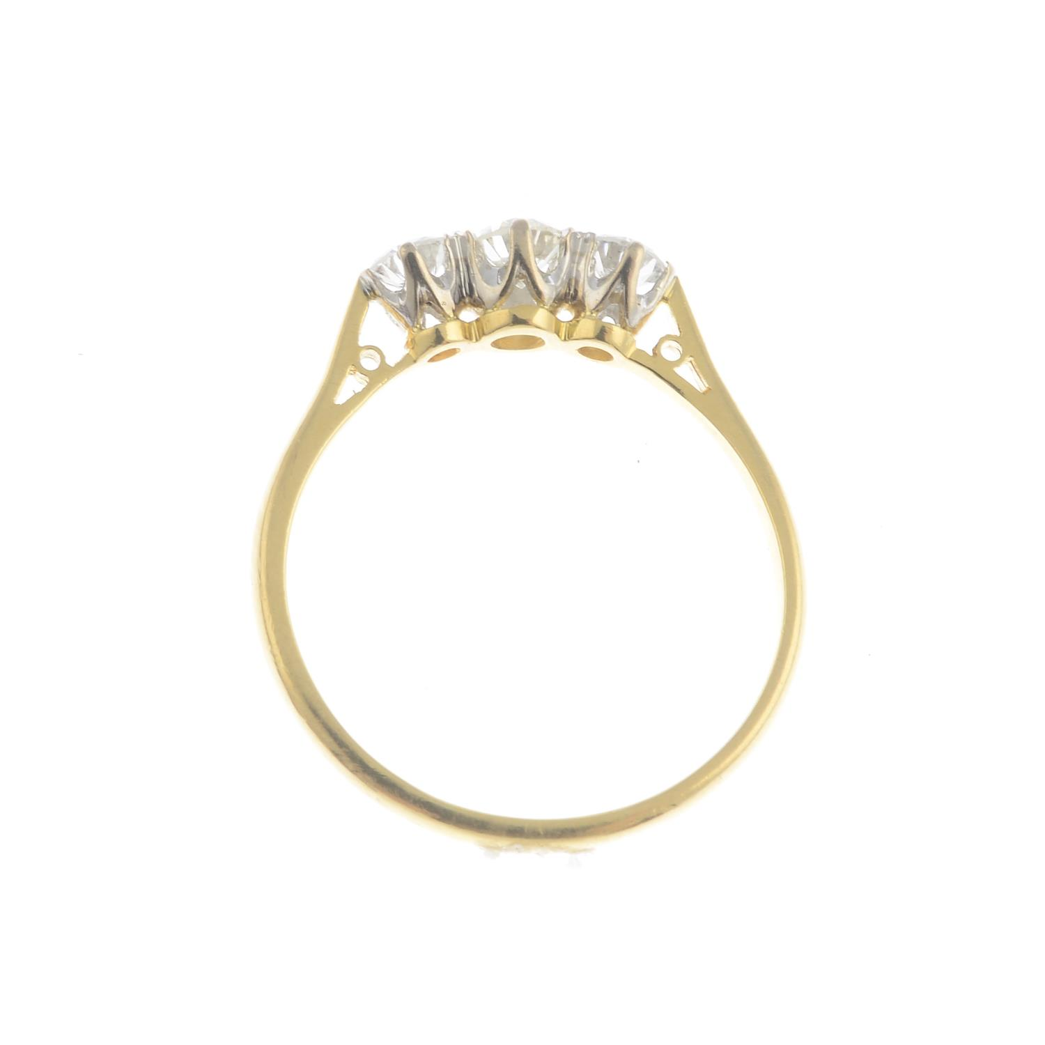 An 18ct gold diamond three-stone ring.Estimated total diamond weight 0.50ct, - Image 3 of 3