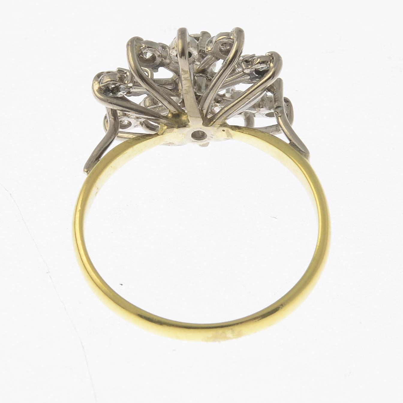 Lot 23 - An 18ct gold diamond snowflake ring.Estimated total diamond weight 0.70ct,