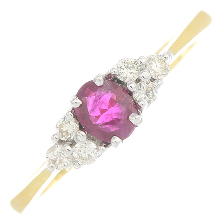Lot 43 - A ruby and diamond dress ring.Estimated total diamond weight 0.10ct.Stamped 750.
