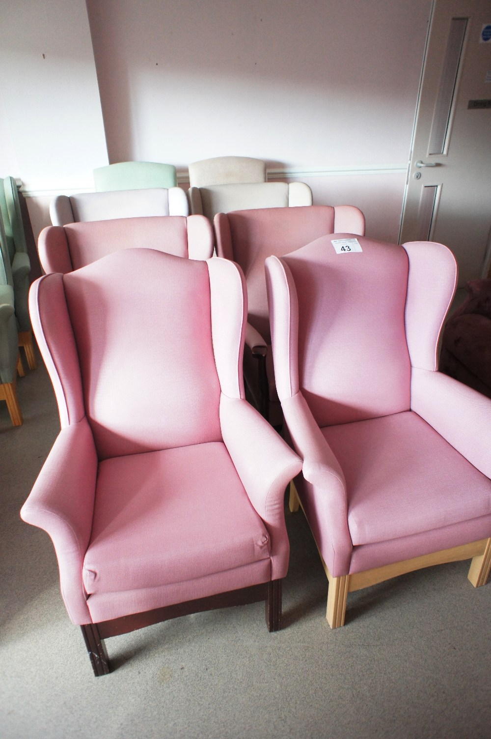 Lot 43 - 6 various easy clean upholstered winged armchairs and two other armchairs (located in room 18, Davey