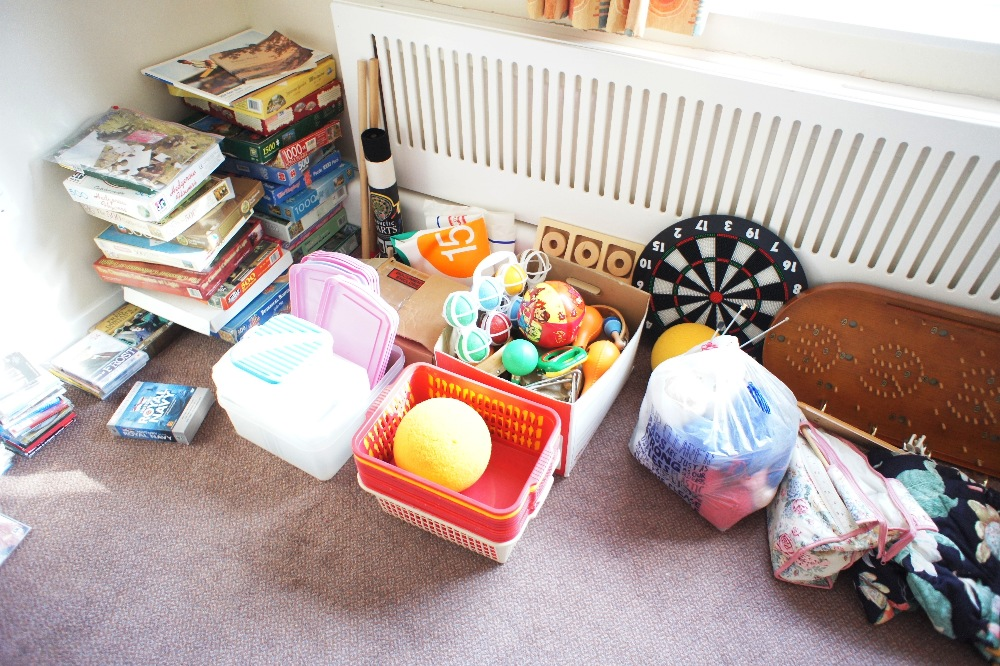 Lot 29 - a quantity of miscellaneous jigsaws, videos, board games, small indoor games and craft items etc. (