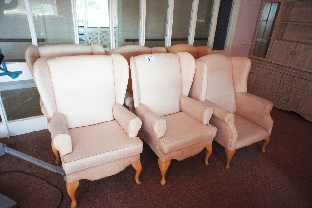 Lot 50 - 6 fawn easy clean upholstered winged armchairs (located in room 18, Davey Court)
