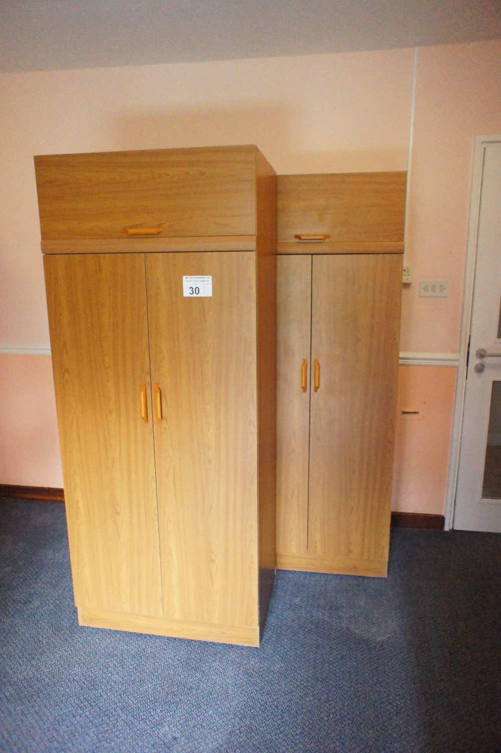 Lot 30 - 3 matching woodgrained finished two door single wardrobes (located in room 16, Davey Court)