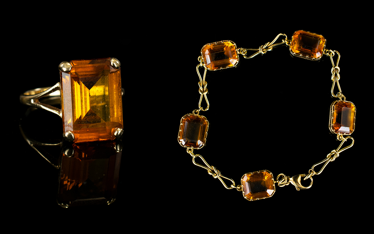 Lot 127 - A 9ct Yellow Gold And Citrine Bracelet A