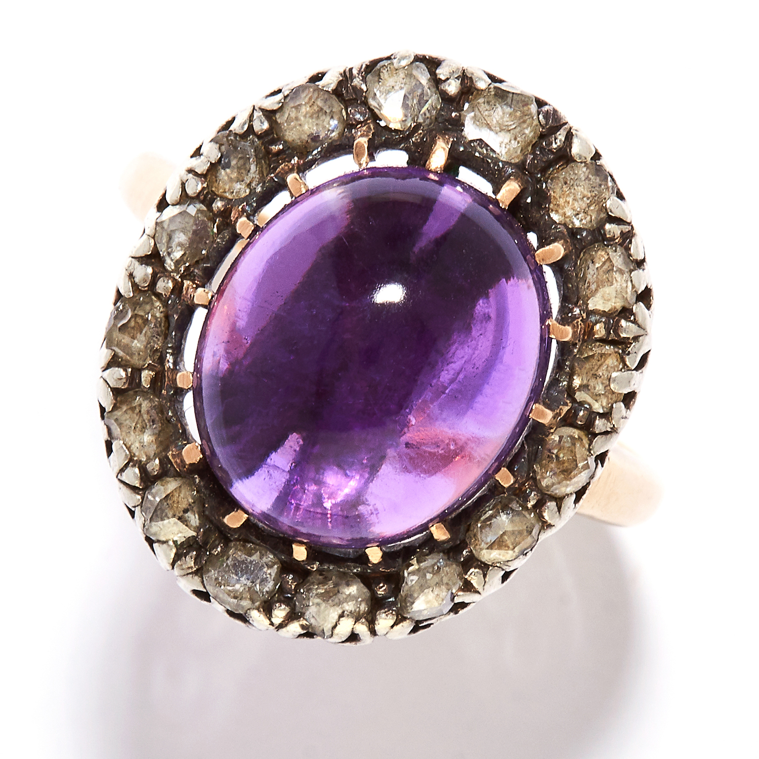 ANTIQUE AMETHYST AND DIAMOND RING in high carat yellow gold and silver, the oval cabochon amethyst