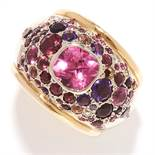 TOURMALINE AND DIAMOND BOMBE RING in 18ct yellow gold, of bombe design, set with a central cushion