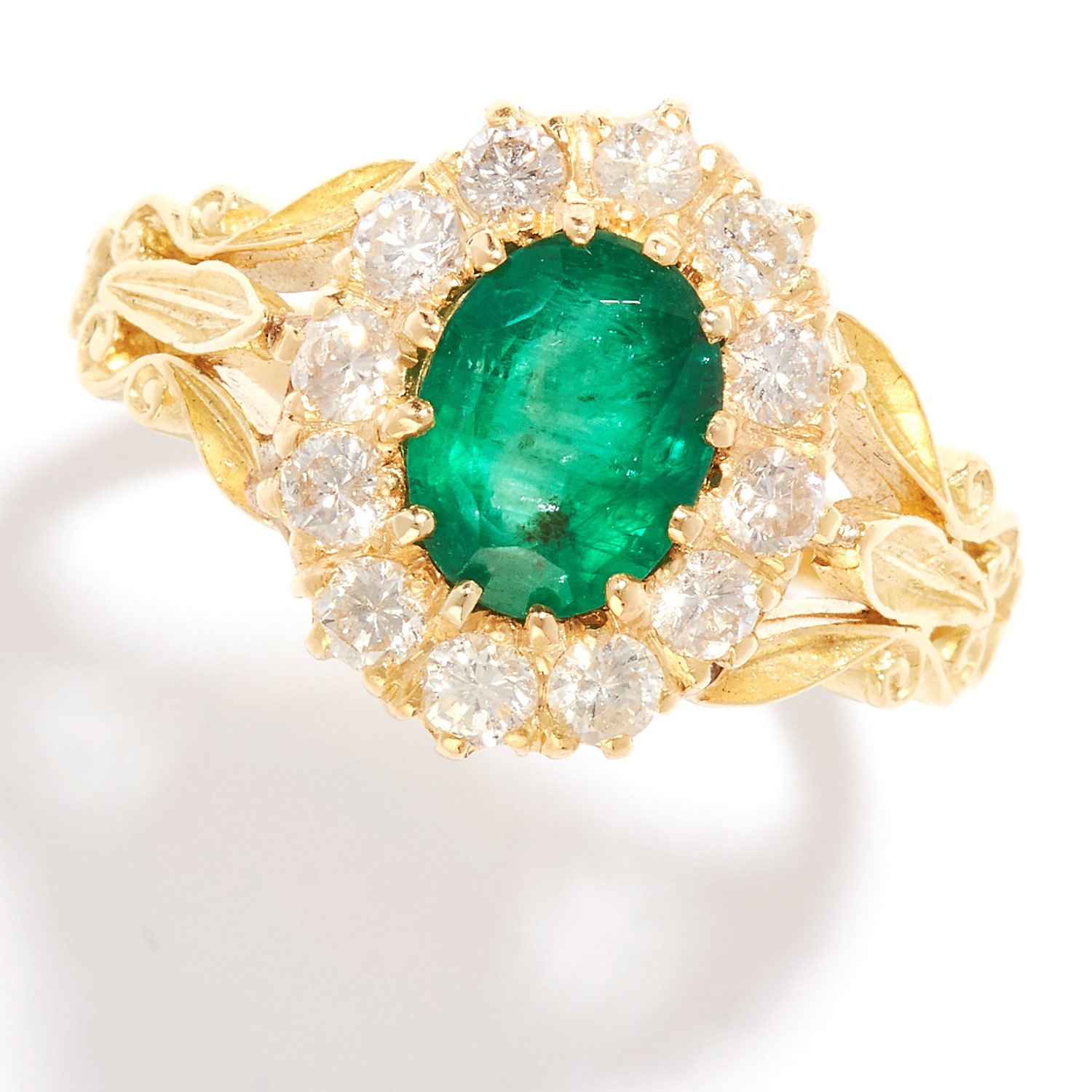 EMERALD AND DIAMOND CLUSTER RING in 18ct yellow gold, set with an oval cut emerald in a cluster of