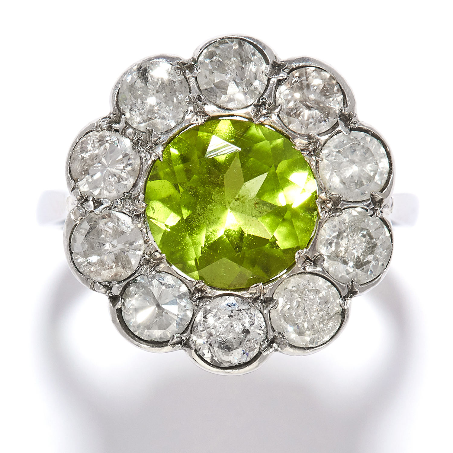 PERIDOT AND DIAMOND CLUSTER RING in platinum or white gold, the round cut peridot encircled by