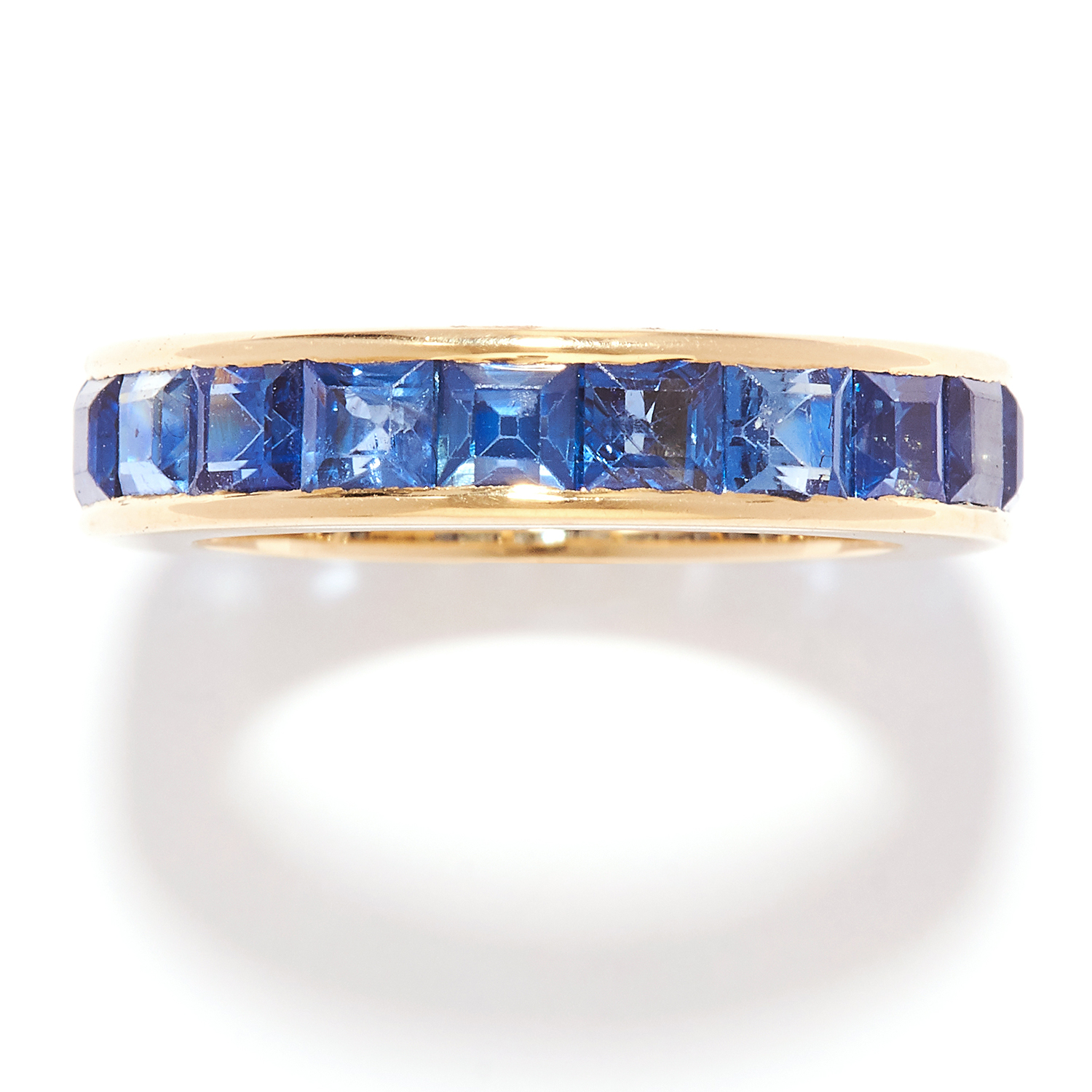 SAPPHIRE ETERNITY BAND RING in 18ct yellow gold, set with square cut sapphires, British hallmarks,