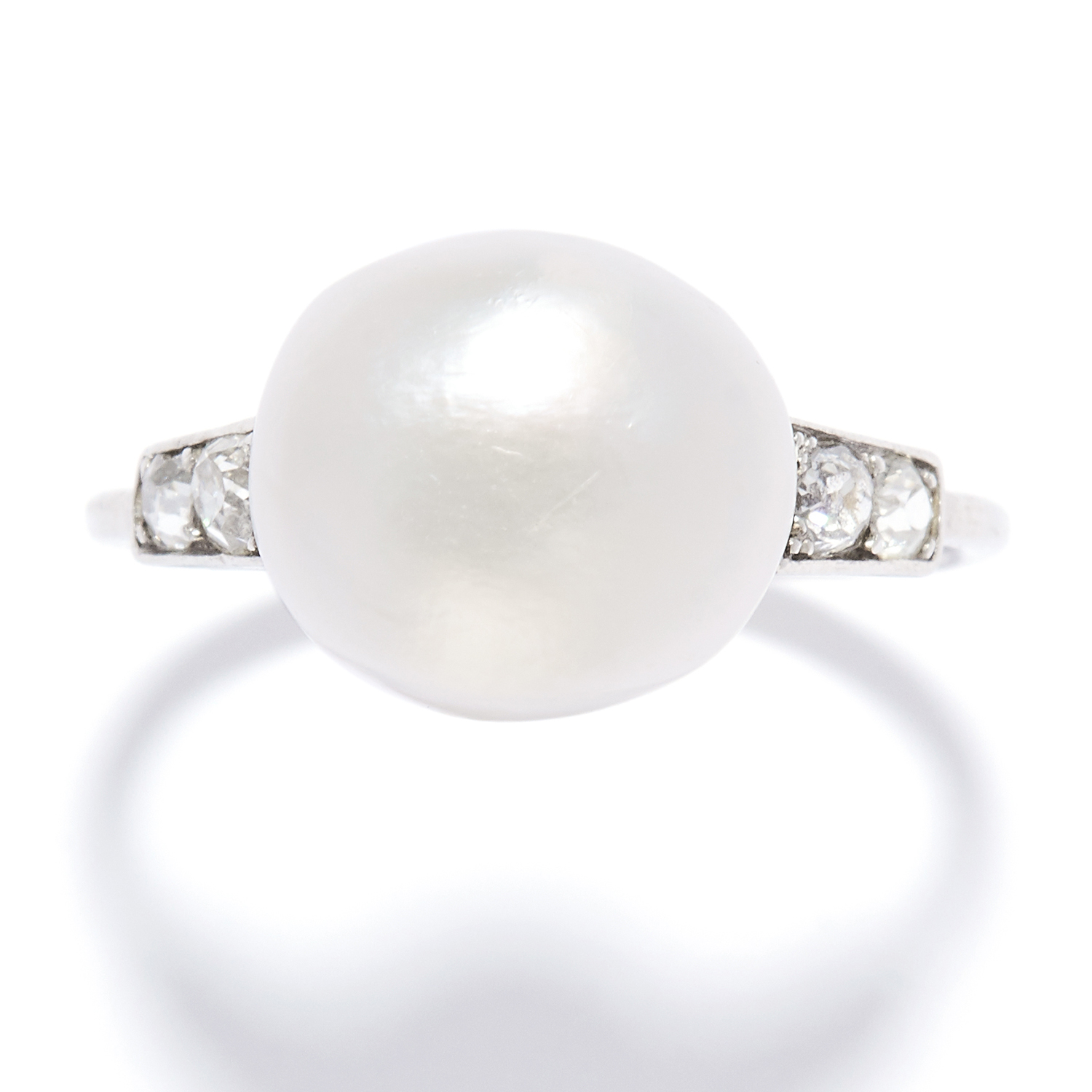 ANTIQUE NATURAL PEARL AND DIAMOND RING in platinum, the pearl of 11.3mm flanked by pairs of old