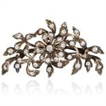 A PASTE FLORAL SPRAY BROOCH in silver, designed as a floral spray, jewelled with round cut paste