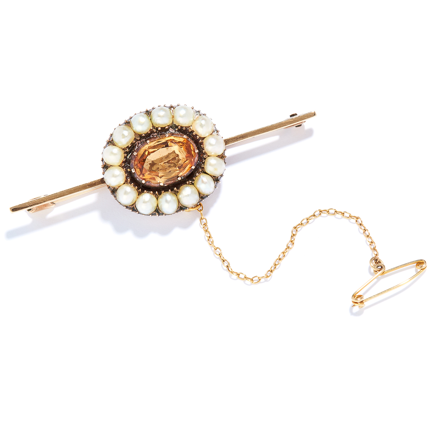 ANTIQUE IMPERIAL TOPAZ AND PEARL BAR BROOCH in high carat yellow gold, set with an oval cut topaz in