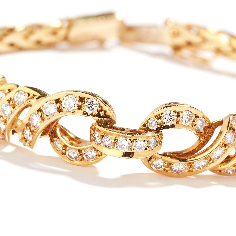 DIAMOND FANCY LINK BRACELET, BULGARI in 18ct yellow gold, the central interlocking motif set with - Bild 2 aus 2
