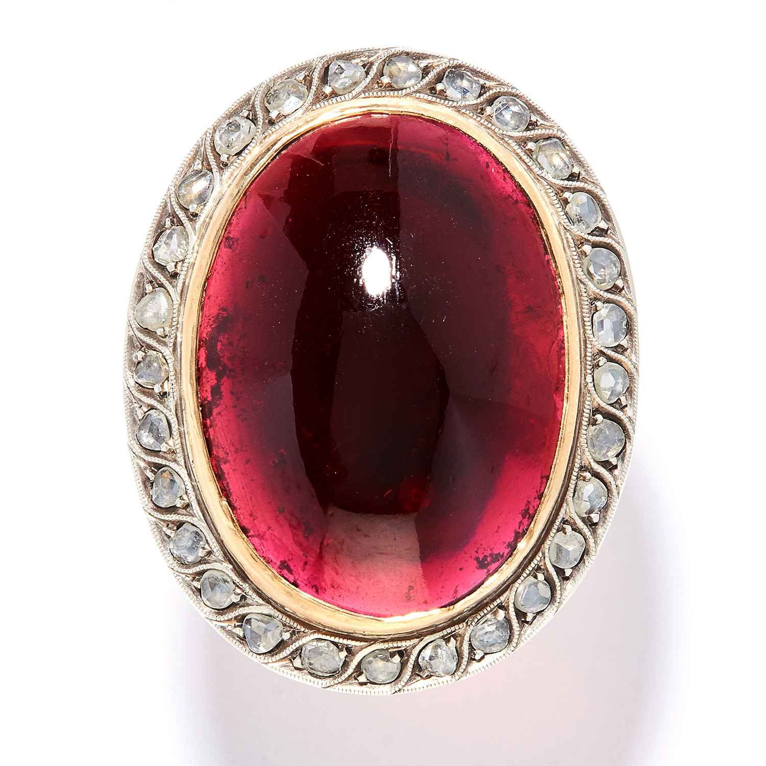 ANTIQUE GARNET AND DIAMOND RING in high carat yellow gold and silver, the large oval cabochon garnet