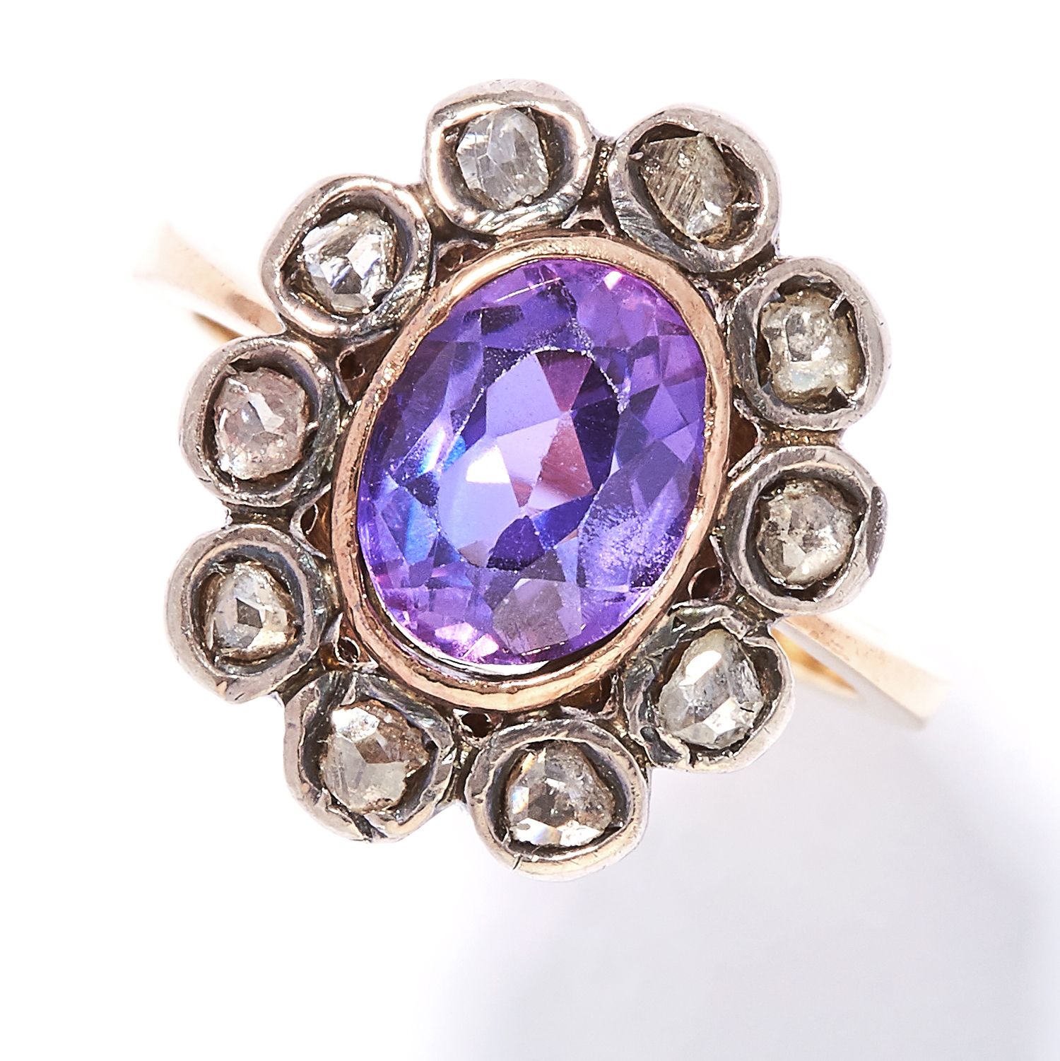 AMETHYST AND DIAMOND RING in yellow gold and silver, oval cut amethyst encircled by rose cut