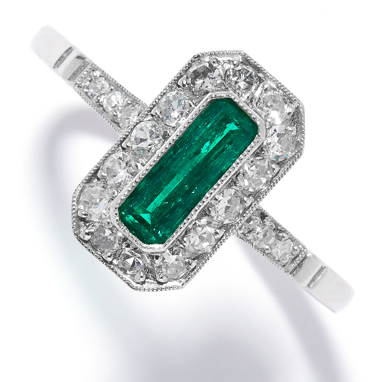 EMERALD AND DIAMOND DRESS RING in platinum, set with an emerald cut emerald in a cluster of old
