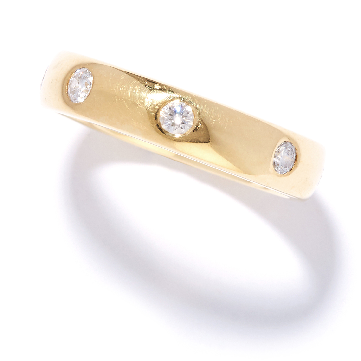 Los 51 - DIAMOND ETERNITY BAND RING in 18ct yellow gold, set with eight round cut diamonds, British
