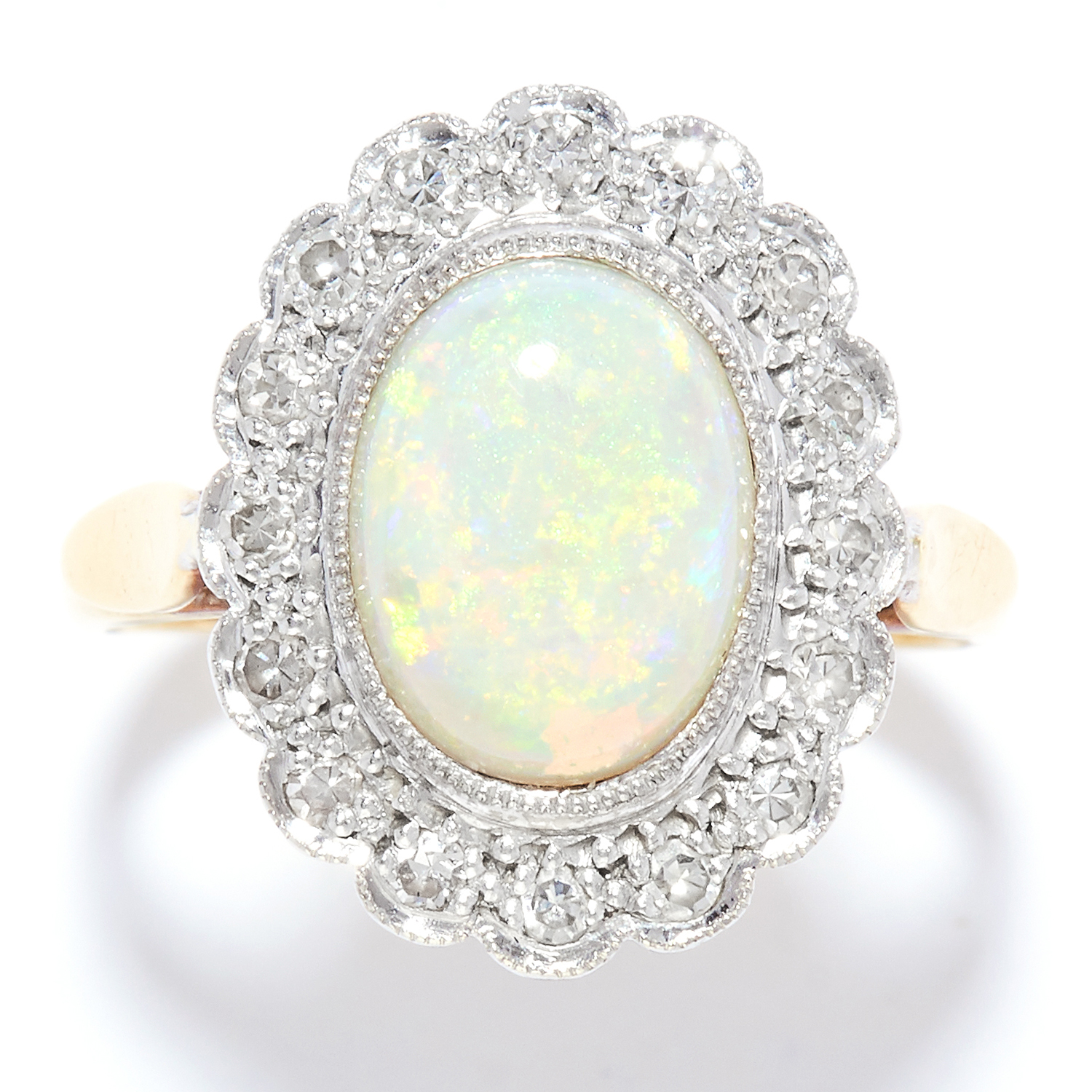 OPAL AND DIAMOND CLUSTER RING in yellow gold, set with a cabochon opal in a cluster of round cut