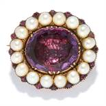 ANTIQUE AMETHYST AND PEARL BROOCH in high carat yellow gold, set with an oval cut amethyst in a