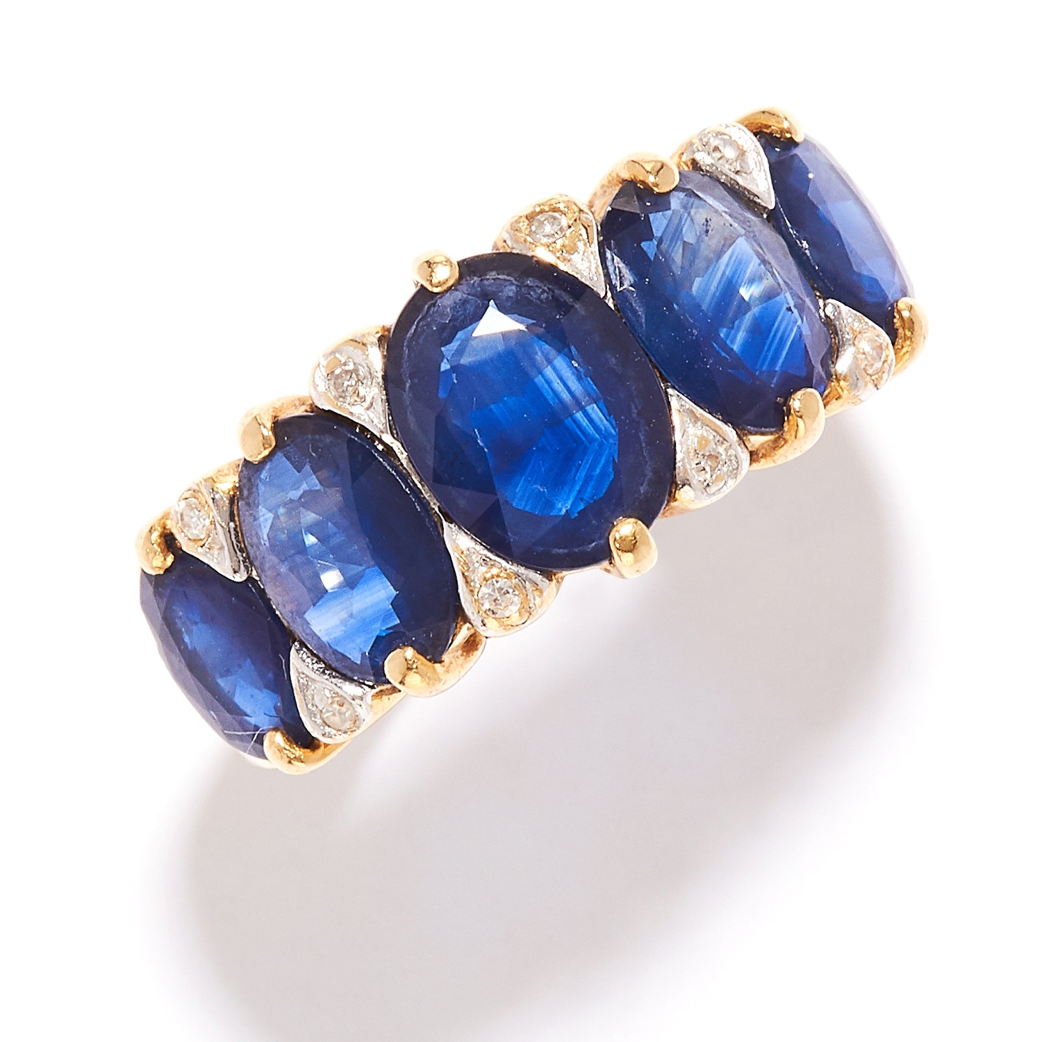 SAPPHIRE AND DIAMOND RING in high carat yellow gold, set with a row of five graduated oval cut