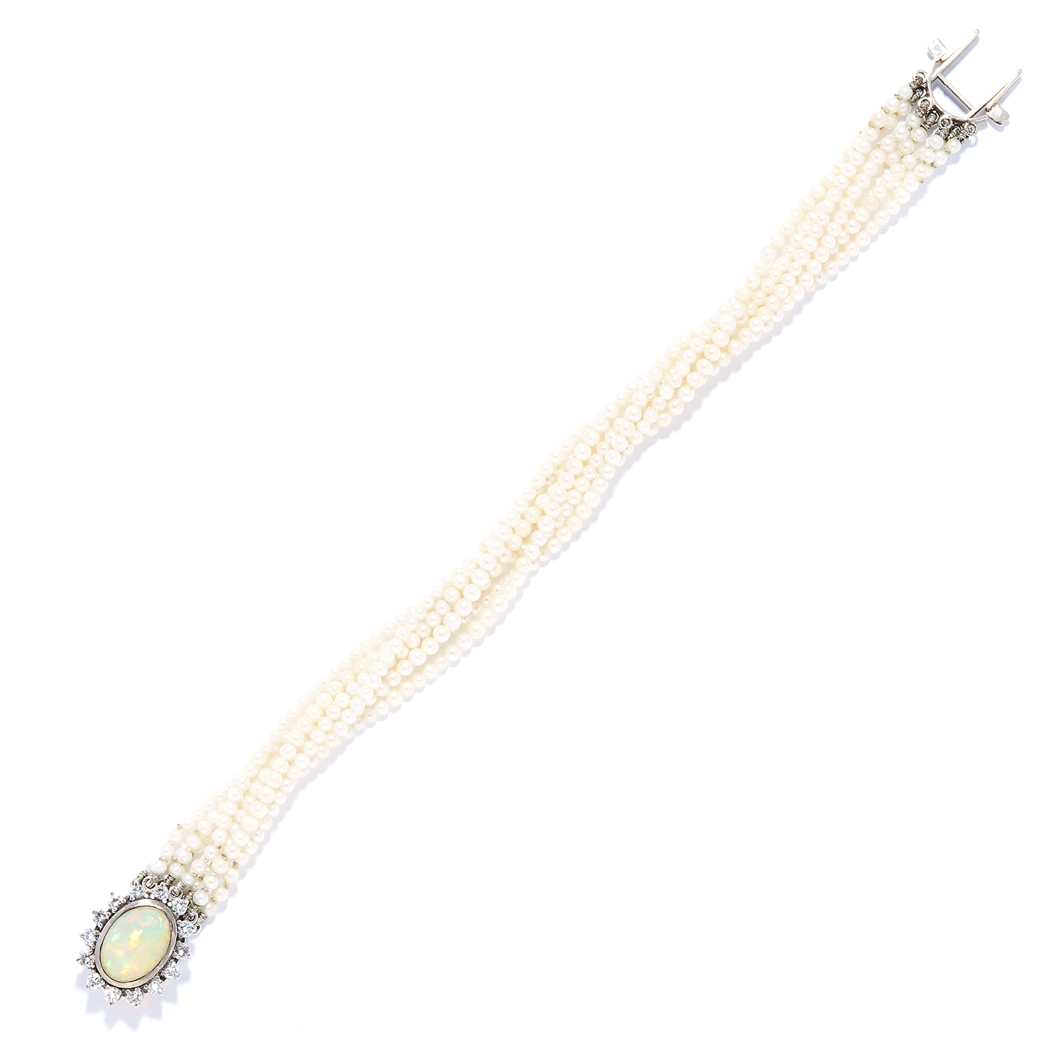 PEARL, OPAL AND DIAMOND BRACELET in white gold or platinum, comprising of seven rows of pearls