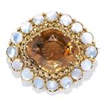 AN ANTIQUE MOONSTONE AND ZIRCON BROOCH in high carat yellow gold, set with a cushion cut zircon