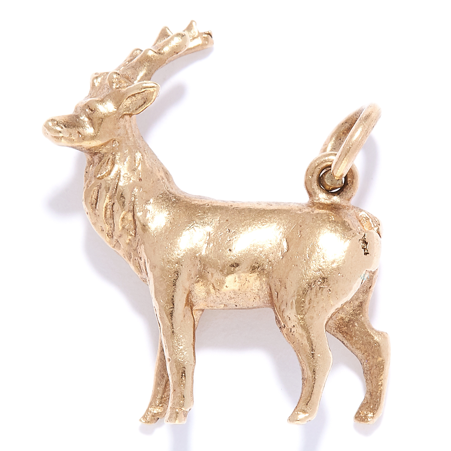 A DEER CHARM / PENDANT in yellow gold, designed as a deer, British hallmarks, 1.7cm, 3.8g.