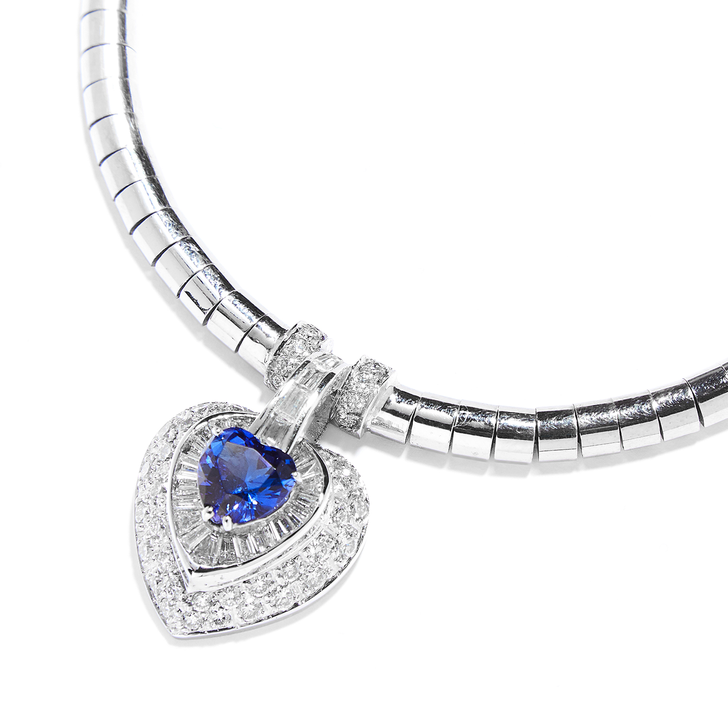 TANZANITE AND DIAMOND PENDANT NECKLACE in 18ct white gold, the fancy link chain suspending a heart