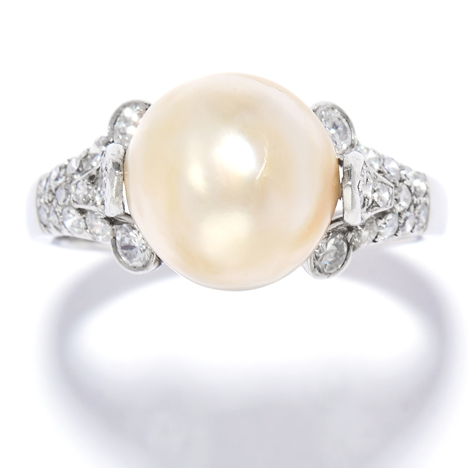 NATURAL PEARL AND DIAMOND RING, BULGARI in platinum, the 10.3mm natural pearl between scrolling