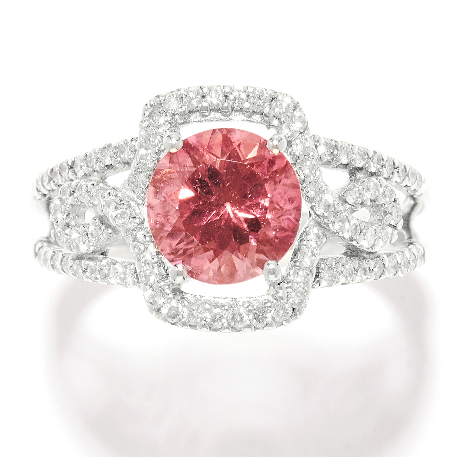 TOURMALINE AND DIAMOND DRESS RING in white gold, set with a round cut pink tourmaline and round