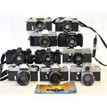 Group of Ten 35mm SLRs with Lenses.