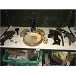 A quantity of African carved tribal wooden items.