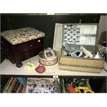 A vintage wicker sewing basket and contents, tin of buttons, work stool etc.